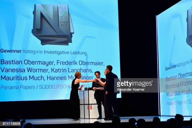 Jury member Giovanni di Lorenzo hands over the 'Investigative Journalism' Award to Vanessa Wormer and Frederik Obermaier for 'Panama Papers' at the...