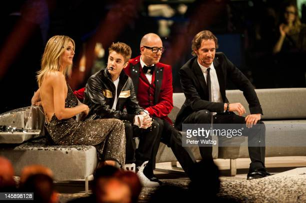 Jury member Heidi Klum Justin Bieber Thomas Rath and Thomas Hayo during the 'Germany's Next Topmodel' Finals at the LanxessArena on June 07 2012 in...