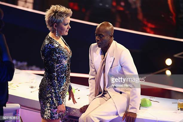 Jury member Inka Bause chats with Bruce Darnell during the 'Das Supertalent' final show on December 12 2015 in Cologne Germany