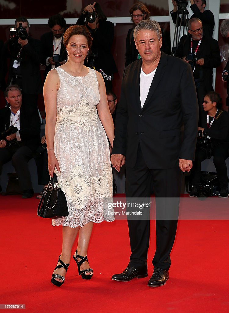 Jury member Martina Gedeck and Markus Imboden attends 'La Jalousie' Premiere during the 70th Venice International Film Festival at the Sala Grande on September 5, 2013 in Venice, Italy.