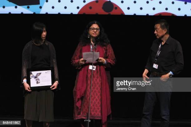 Jury member Rashmi Doraiswamy presents the NETPAC Award for World or International Asian Film Premiere for 'The Great Buddha' at the 2017 TIFF Awards...