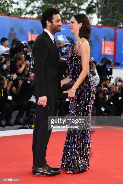 Jury member Rebecca Hall and Morgan Spector walk the red carpet ahead of the 'Downsizing' screening and Opening Ceremony during the 74th Venice Film...