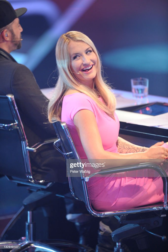 Jury member Sarah Connor smiles to the audience during 'The X Factor Live' TVShow on November 15 2011 in Cologne Germany