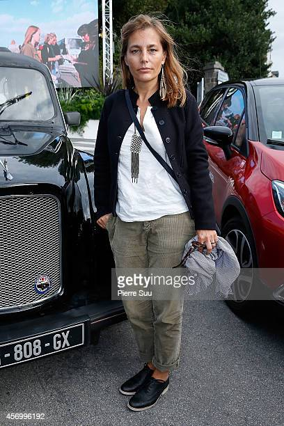 Jury Member Sophie Duez poses in front of a black cab at 'Palais des arts' on October 10 2014 in Dinard France
