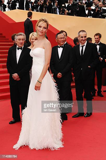 Jury Member Uma Thurman poses with fellow members as she attends the Opening Ceremony at the Palais des Festivals during the 64th Cannes Film...