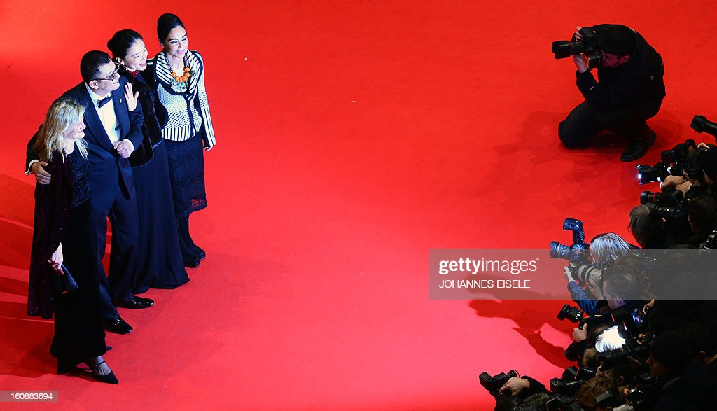 Jury member US cinematographer Ellen Kuras, Jury president Hong Kong Chinese director Wong Kar-Wai and his wife Esther Wong and Jury member and Iranian director Shirin Neshat, pose on the red carpet of the opening film of the Berlinale film festival , 'Yi dai zong shi' (The Grandmaster) in Berlin, on February 7, 2013. The 63rd Berlin film festival opens with a gala screening of Chinese director Wong Kar Wai's martial arts epic about the mentor of kung fu superstar Bruce Lee. AFP PHOTO / JOHANNES EISELE