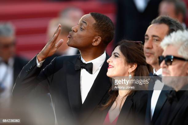 Jury member Will Smith blows a kiss as he poses with fellow jury members Agnes Jaoui Paolo Sorrentino and President of the jury Pedro Almodovar as...
