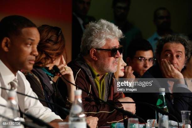 Jury member Will Smith listens and Jury member Paolo Sorrentino listen as President of the jury Pedro Almodovar speaks during the Jury press...