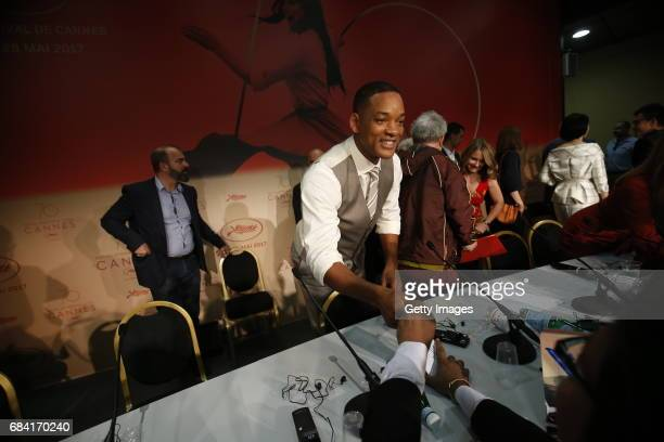 Jury member Will Smith signs autographs during the Jury press conference during the 70th annual Cannes Film Festival at Palais des Festivals on May...