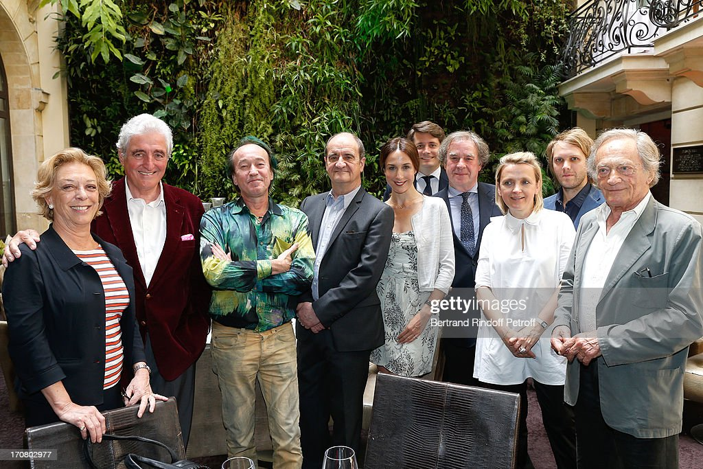 Jury members Anne de la Baume, Jean-Loup Dabadie, botanist Patrick Blanc, Pierre Lescure, Elsa Zylberstein, Alexandre Duval-Stalla, Jean-Michel Wilmotte, Florence Berthout, Florient Zeller and Philippe Tesson attend the Jury of the Price of the Cultural Personality of the year portrait session at Hotel Pershing Hall on June 18, 2013 in Paris, France.