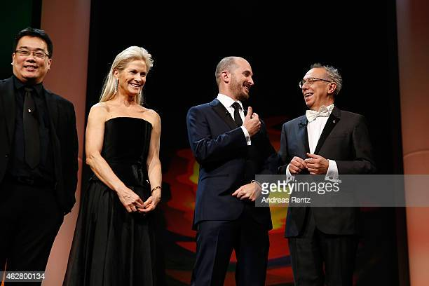 Jury members Bong Joonho Martha De Laurentiis Darren Aronofsky and director of festival Dieter Kosslick appear on stage during the opening ceremony...