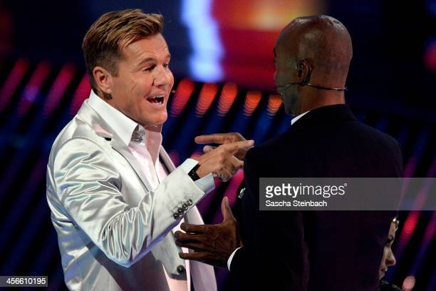 Jury members Bruce Darnell and Dieter Bohlen joke during the finals of 'Das Supertalent' at Coloneum on December 14 2013 in Cologne Germany