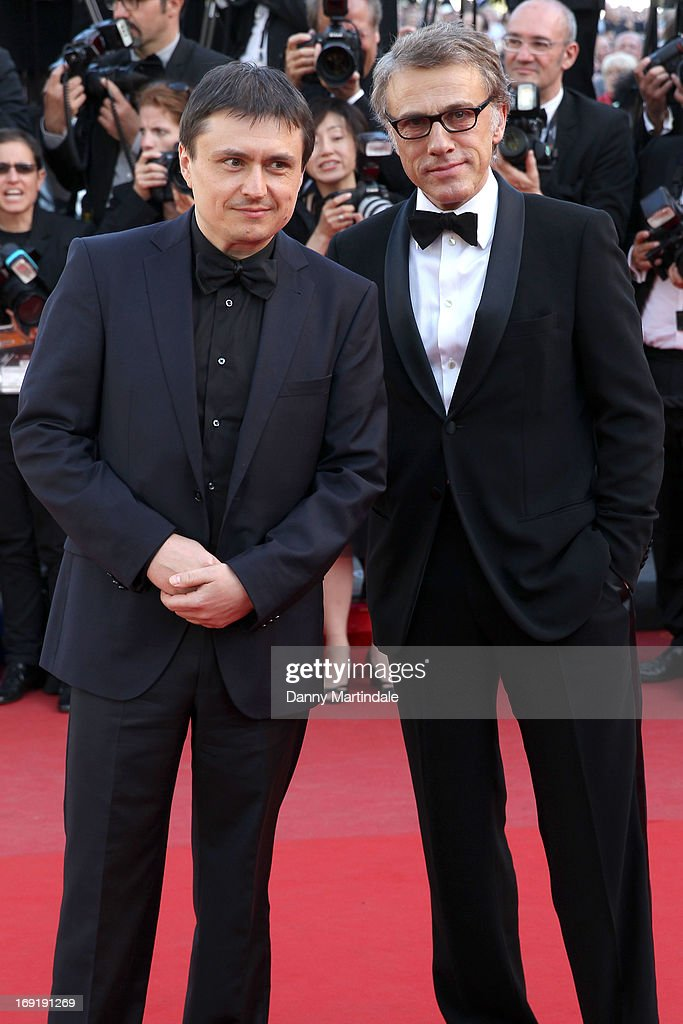 Jury members Christoph Waltz (R) and Cristian Mungiu attend the Premiere of 'Behind The Candelabra' during the 66th Annual Cannes Film Festival at the Palais des Festivals on May 21, 2013 in Cannes, France.