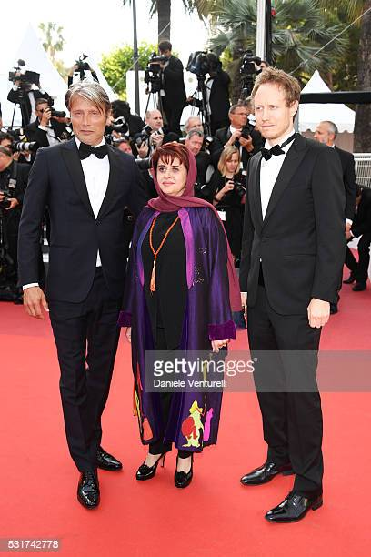 Jury members Danish actor Mads Mikkelsen Iranian producer Katayoon Shahabi and Hungarian director Laszlo Nemes attends the 'Loving' premiere during...