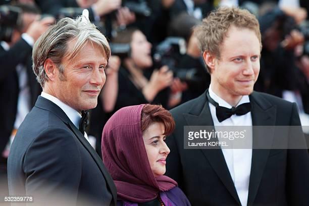 Jury members Danish actor Mads Mikkelsen Iranian producer Katayoon Shahabi and Hungarian director Laszlo Nemes attend the 'Loving' red carpet...