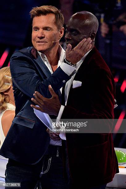 Jury members Dieter Bohlen and Bruce Darnell hug each other during the first live show of 'Das Supertalent' at Coloneum on November 30 2013 in...