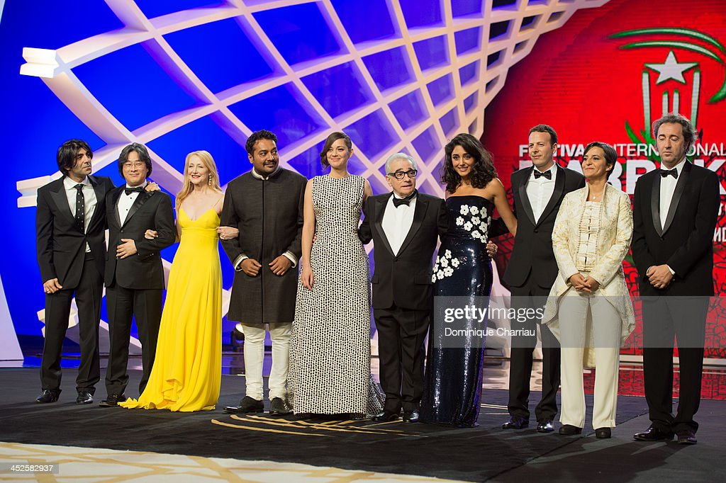 Jury members Fatih Akin, Park Chan-wook, Patricia Clarkson, Anurag Kashyap, <a gi-track='captionPersonalityLinkClicked' href=/galleries/search?phrase=Marion+Cotillard&family=editorial&specificpeople=215303 ng-click='$event.stopPropagation()'>Marion Cotillard</a>, Martin Scorsese, <a gi-track='captionPersonalityLinkClicked' href=/galleries/search?phrase=Golshifteh+Farahani&family=editorial&specificpeople=5535488 ng-click='$event.stopPropagation()'>Golshifteh Farahani</a>, <a gi-track='captionPersonalityLinkClicked' href=/galleries/search?phrase=Amat+Escalante&family=editorial&specificpeople=5350930 ng-click='$event.stopPropagation()'>Amat Escalante</a>, Narjiss Nejjar and <a gi-track='captionPersonalityLinkClicked' href=/galleries/search?phrase=Francois+Cluzet&family=editorial&specificpeople=626602 ng-click='$event.stopPropagation()'>Francois Cluzet</a> pose during the opening ceremony of the 13th Marrakesh International Film Festival on November 29, 2013 in Marrakech, Morocco.