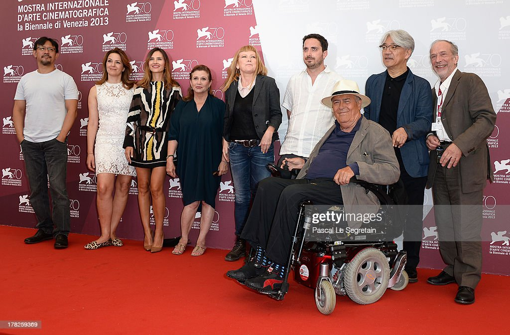 Jury members Jiang Wen, Martina Gedeck, Virginie Ledoyen, Carrie Fisher, Andrea Arnold, Pablo Larrain,the jury President Bernardo Bertolucci, Ryuichi Sakamoto and Renato Berta attend the International Jury Photocall during the 70th Venice International Film Festival at the Palazzo del Casino on August 28, 2013 in Venice, Italy.