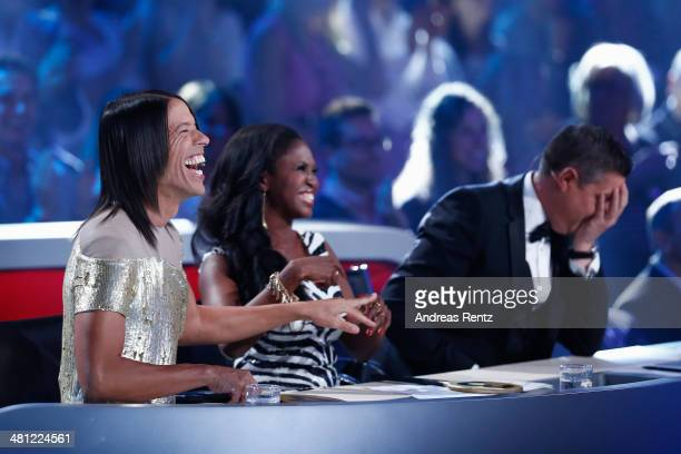 Jury members Jorge Gonzalez Motsi Mabuse and Joachim Llambi attend the 1st Show of 'Let's Dance' on RTL at Coloneum on March 28 2014 in Cologne...