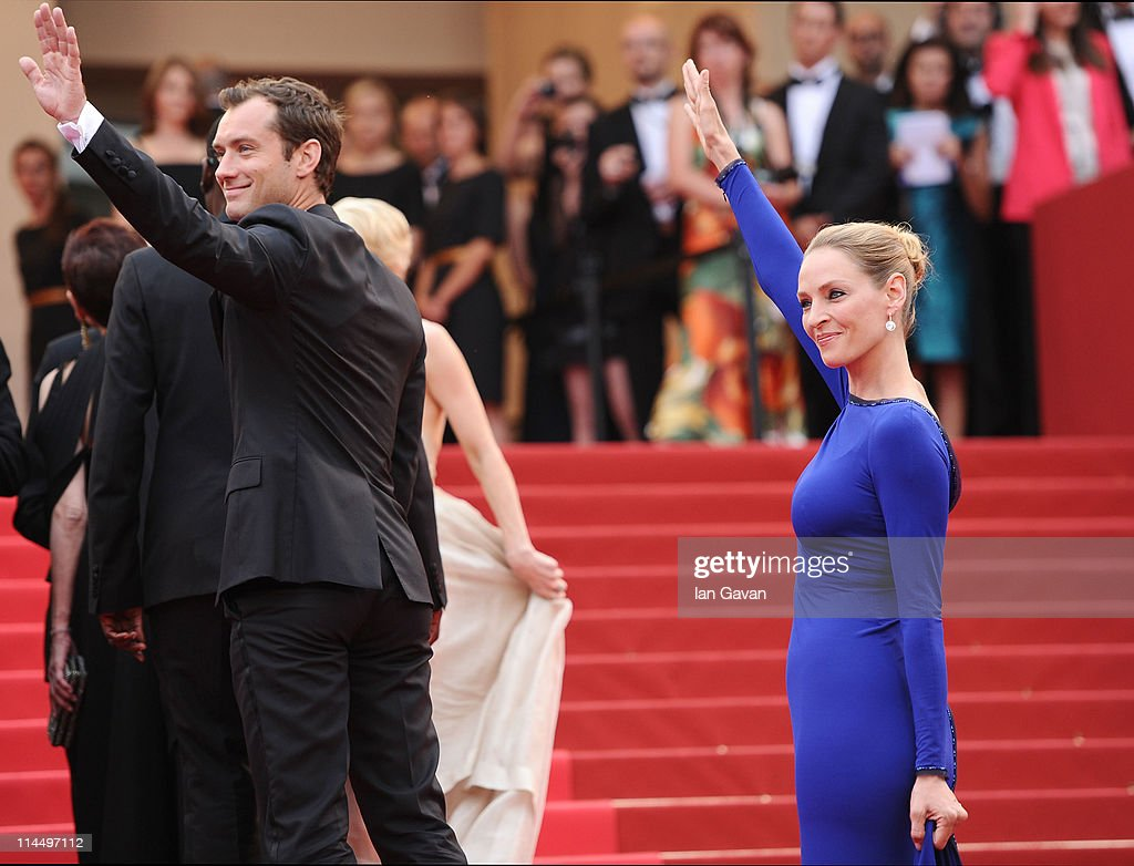 Jury Members Jude Law and Uma Thurman attend the 'Les BienAimes' premiere at the Palais des Festivals during the 64th Cannes Film Festival on May 22...