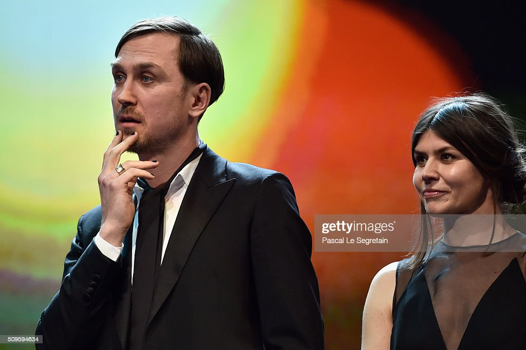 Jury members <a gi-track='captionPersonalityLinkClicked' href=/galleries/search?phrase=Lars+Eidinger&family=editorial&specificpeople=2984804 ng-click='$event.stopPropagation()'>Lars Eidinger</a> and Malgorzata Szumowska pose on stage during the opening ceremony of the 66th Berlinale International Film Festival Berlin at Berlinale Palace on February 11, 2016 in Berlin, Germany.