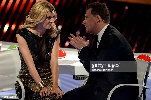 Jury members Lena Gercke and Guido Maria Kretschmer look on during the finals of 'Das Supertalent' at Coloneum on December 14 2013 in Cologne Germany