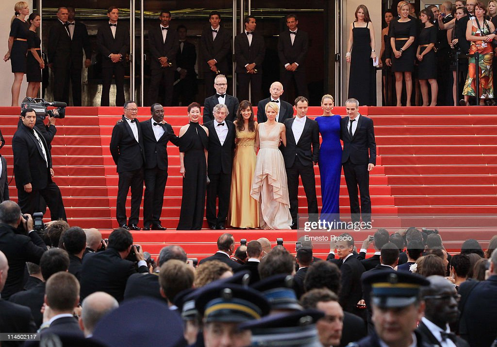Jury Members Mahamat-Saleh Haroun, Johnnie To, Nansun Shi, Martina Gusman, Jury President Robert De Niro, Linn Ullmann, Jude Law, Uma Thurman, Olivier Assayas, Thierry Fremaux, and Gilles Jacob attend the 'Les Bien-Aimes' premiere at the Palais des Festivals during the 64th Cannes Film Festival on May 22, 2011 in Cannes, France.
