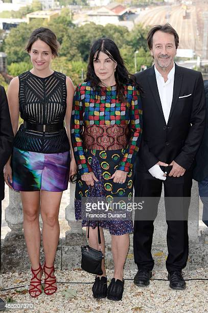 Jury members Marie Gillain Carole Laure and JeanHugue Anglade attend the Jury photocall during the 8th Angouleme FrenchSpeaking Film Festival on...