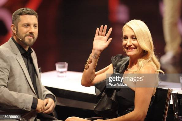 Jury members Mirko Bogojevic and Sarah Connor during 'The X Factor Live' TVShow on October 25 2011 in Cologne Germany