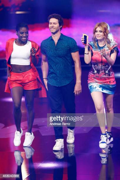Jury members Nikeata Thompson Howard Donald and Palina Rojinski smile during the 1st live show of 'Got to Dance' on August 1 2014 in Cologne Germany