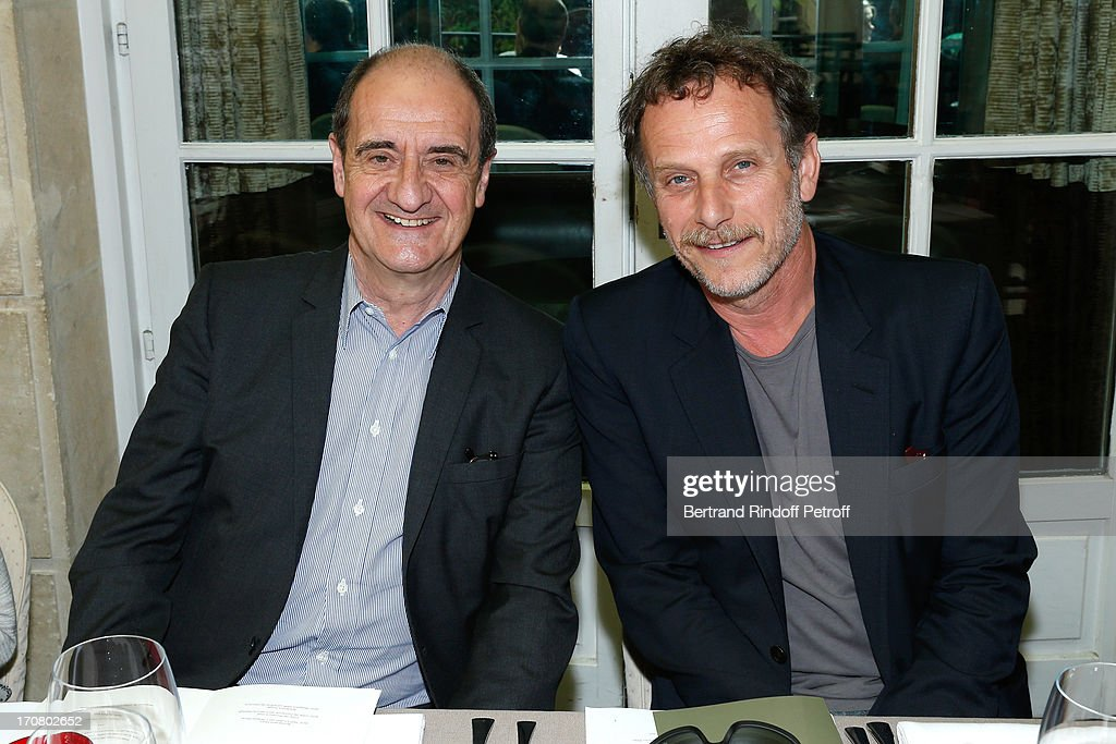 Jury members Pierre Lescure and Charles Berling attend the Jury of the Price of the Cultural Personality of the year portrait session at Hotel Pershing Hall on June 18, 2013 in Paris, France.