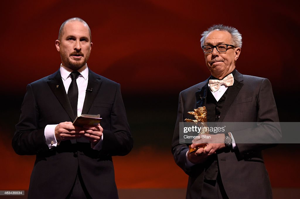 Jury president <a gi-track='captionPersonalityLinkClicked' href=/galleries/search?phrase=Darren+Aronofsky&family=editorial&specificpeople=841696 ng-click='$event.stopPropagation()'>Darren Aronofsky</a> and festival director <a gi-track='captionPersonalityLinkClicked' href=/galleries/search?phrase=Dieter+Kosslick&family=editorial&specificpeople=213030 ng-click='$event.stopPropagation()'>Dieter Kosslick</a> present the golden bear for best film on stage during the Closing Ceremony of the 65th Berlinale International Film Festival at Berlinale Palace on February 14, 2015 in Berlin, Germany.