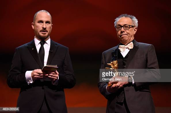 Jury president Darren Aronofsky and festival director Dieter Kosslick present the golden bear for best film on stage during the Closing Ceremony of...