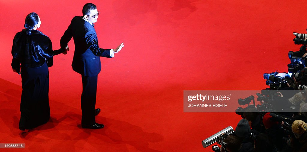 Jury president Hong Kong Chinese director Wong Kar-Wai and his wife Esther Wong pose on the red carpet of the opening film of the Berlinale film festival , 'Yi dai zong shi' (The Grandmaster) in Berlin, on February 7, 2013. The 63rd Berlin film festival opens with a gala screening of Chinese director Wong Kar Wai's martial arts epic about the mentor of kung fu superstar Bruce Lee.