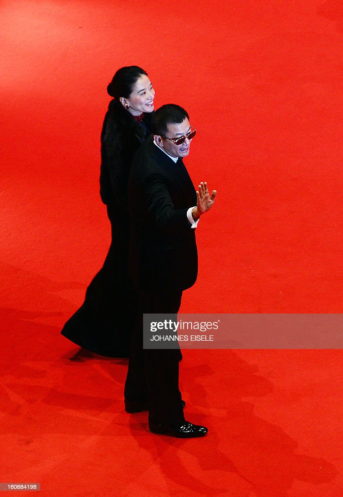 Jury president Hong Kong Chinese director Wong Kar-Wai and his wife Esther Wong pose on the red carpet of the opening film of the Berlinale film festival , 'Yi dai zong shi' (The Grandmaster) in Berlin, on February 7, 2013. The 63rd Berlin film festival opens with a gala screening of Chinese director Wong Kar Wai's martial arts epic about the mentor of kung fu superstar Bruce Lee. AFP PHOTO / JOHANNES EISELE