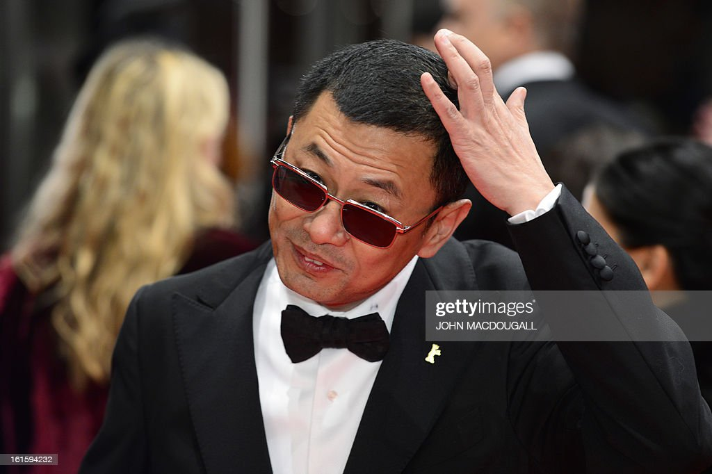 Jury president Hong Kong Chinese director Wong Kar-Wai arrives on the red carpet for the premiere of the film 'Side effects' presented in the Berlinale Competition of the 63rd Berlin International Film Festival in Berlin on February 12, 2013.
