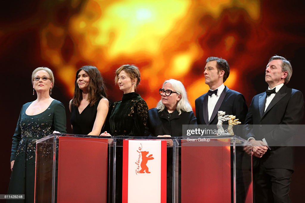 Jury president Meryl Streep and jury members Malgorzata Szumowska, Alba Rohrwacher, Brigitte Lacombe, Clive Owen and Nick James appear on stage during the closing ceremony of the 66th Berlinale International Film Festival on February 20, 2016 in Berlin, Germany.