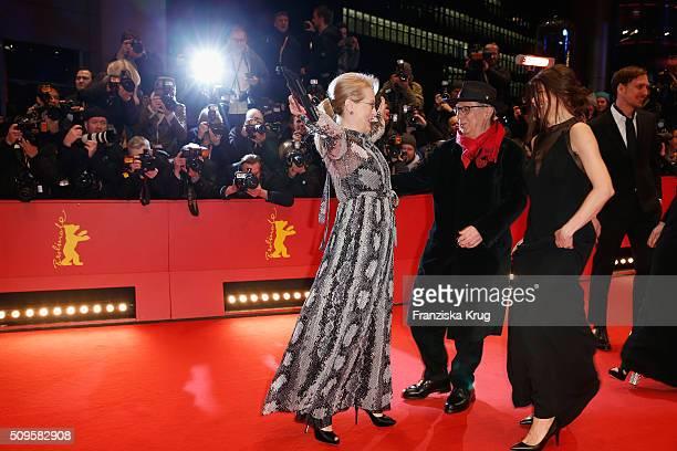Jury president Meryl Streep wearing Prada greets Festival president Dieter Kosslick and Malgorzata Szumowska attend the 'Hail Caesar' premiere during...