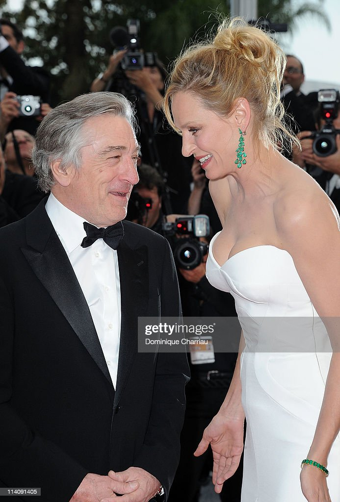 Jury president <a gi-track='captionPersonalityLinkClicked' href=/galleries/search?phrase=Robert+De+Niro&family=editorial&specificpeople=201673 ng-click='$event.stopPropagation()'>Robert De Niro</a> and jury member <a gi-track='captionPersonalityLinkClicked' href=/galleries/search?phrase=Uma+Thurman&family=editorial&specificpeople=171973 ng-click='$event.stopPropagation()'>Uma Thurman</a> attend the Opening Ceremony and 'Midnight In Paris' Premiere at the Palais des Festivals during the 64th Cannes Film Festival on May 11, 2011 in Cannes, France.