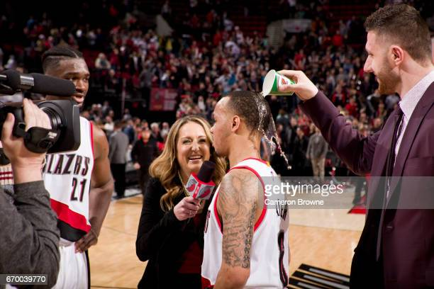 Jusef Nurkic of the Portland Trailblazers pours water on Shabazz Napier of the Portland Trail Blazers on April 10 2017 at the Moda Center in Portland...