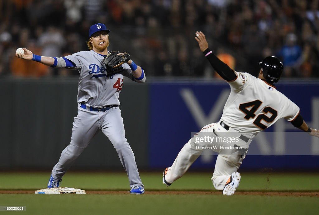 Jusin Turner of the Los Angeles Dodgers completes the double-play over <a gi-track='captionPersonalityLinkClicked' href=/galleries/search?phrase=Gregor+Blanco&family=editorial&specificpeople=4137600 ng-click='$event.stopPropagation()'>Gregor Blanco</a> of the San Francisco Giants in the bottom of the eighth inning at AT&T Park on April 15, 2014 in San Francisco, California. All uniformed team members are wearing jersey number 42 in honor of Jackie Robinson Day.