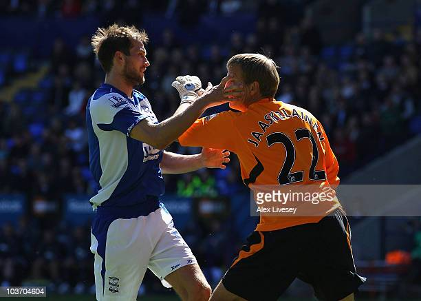 Jussi Jaaskelainen of Bolton Wanderers and Roger Johnson of Birmingham City clash prior to Jussi Jaaskelainen receiving a red card for the incident...