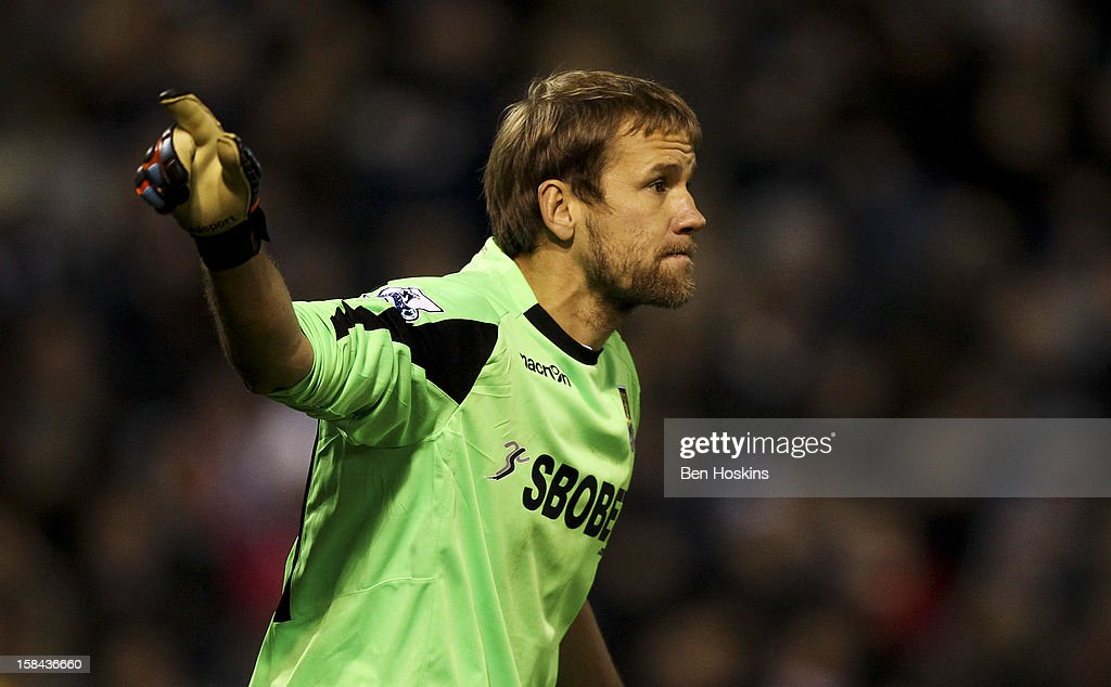 <a gi-track='captionPersonalityLinkClicked' href=/galleries/search?phrase=Jussi+Jaaskelainen&family=editorial&specificpeople=240728 ng-click='$event.stopPropagation()'>Jussi Jaaskelainen</a> of West Ham in action during the Barclays Premier League match between West Bromwich Albion and West Ham United at the Hawthorns on December 16, 2012 in West Bromwich, England.