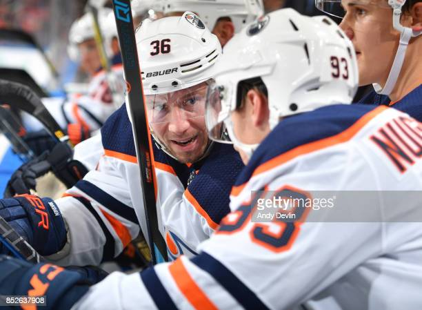 Jussi Jokinen discusses the play with Ryan NugentHopkins of the Edmonton Oilers skates during the preseason game against the Winnipeg Jets on...