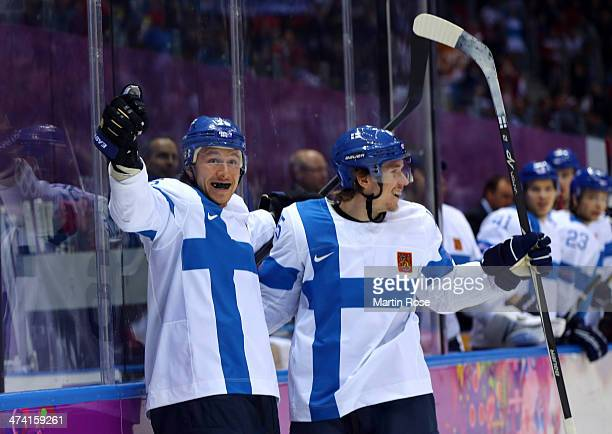 Jussi Jokinen of Finland celebrates his goal in the second period with Sami Vatanen against the United States during the Men's Ice Hockey Bronze...
