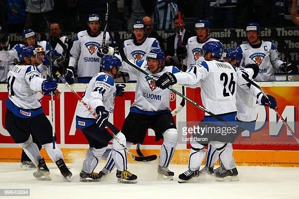 Jussi Jokinen of Finland celebrates with team mates after scoring his teams third goal during the IIHF World Championship qualification round match...