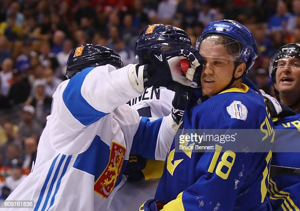 Jussi Jokinen of Team Finland gets the glove up on Jakob Silfverberg of Team Sweden during the first period during the World Cup of Hockey tournament...