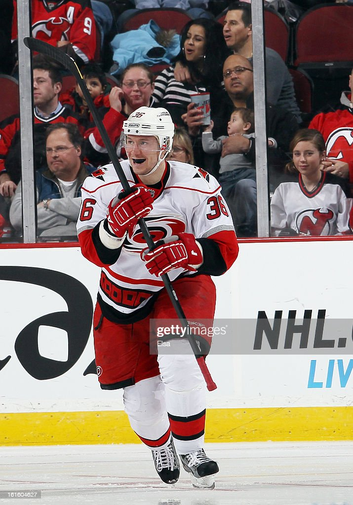 Jussi Jokinen #36 of the Carolina Hurricanes celebrates his goal in the second period against the New Jersey Devils at the Prudential Center on February 12, 2013 in Newark, New Jersey.