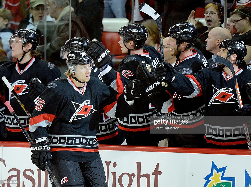 Jussi Jokinen #36 of the Carolina Hurricanes celebrates with teammates after one of his two first period goals against the Florida Panthers during play at PNC Arena on March 2, 2013 in Raleigh, North Carolina. The Hurricanes won 6-2.