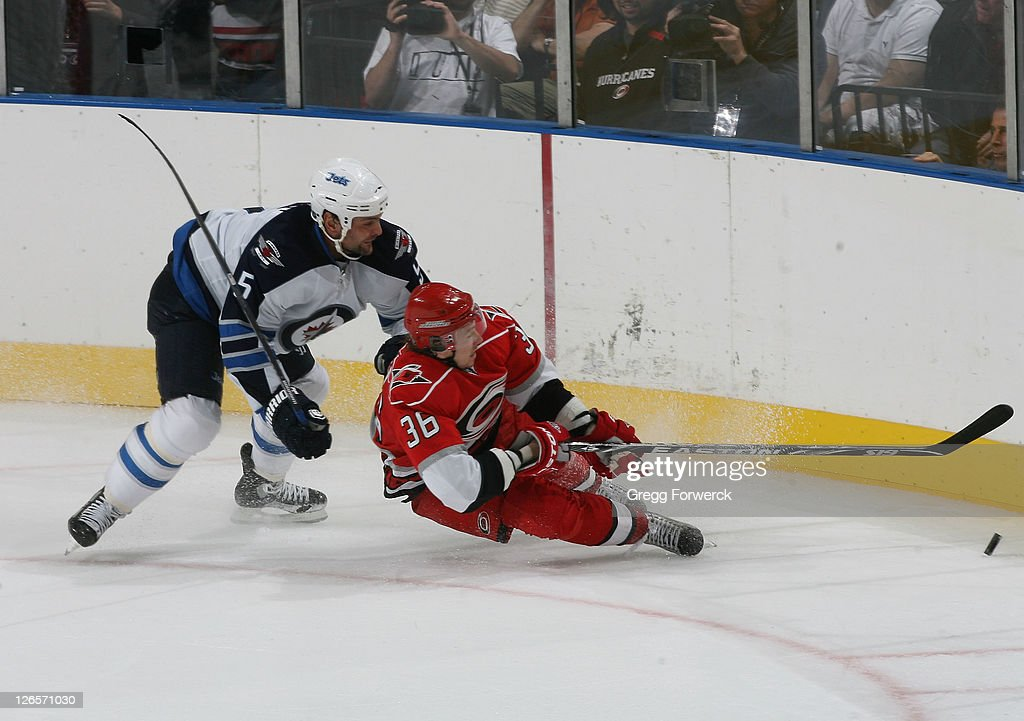 <a gi-track='captionPersonalityLinkClicked' href=/galleries/search?phrase=Jussi+Jokinen&family=editorial&specificpeople=570599 ng-click='$event.stopPropagation()'>Jussi Jokinen</a> #36 of the Carolina Hurricanes gets tangled up with Mark Stuart #5 of the Winnipeg Jets and goes down during an NHL preseason game on September 25, 2011 at Time Warner Arena in Charlotte, North Carolina.